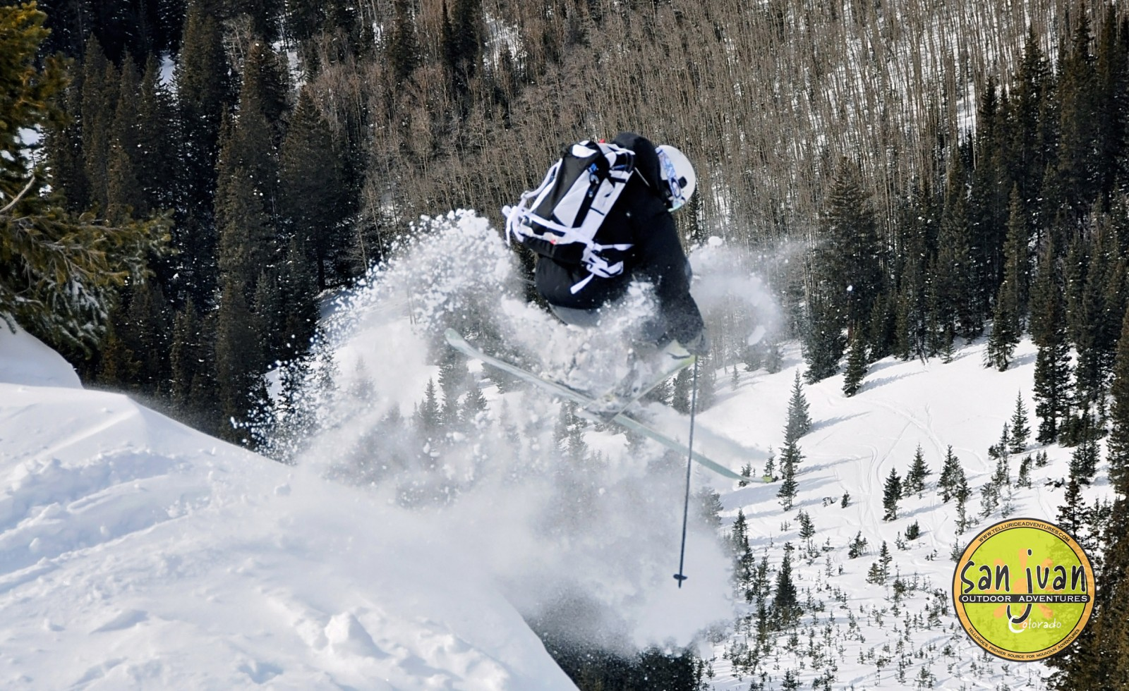 Backcountry skier launches of pillow of snow in Telluride Colorado