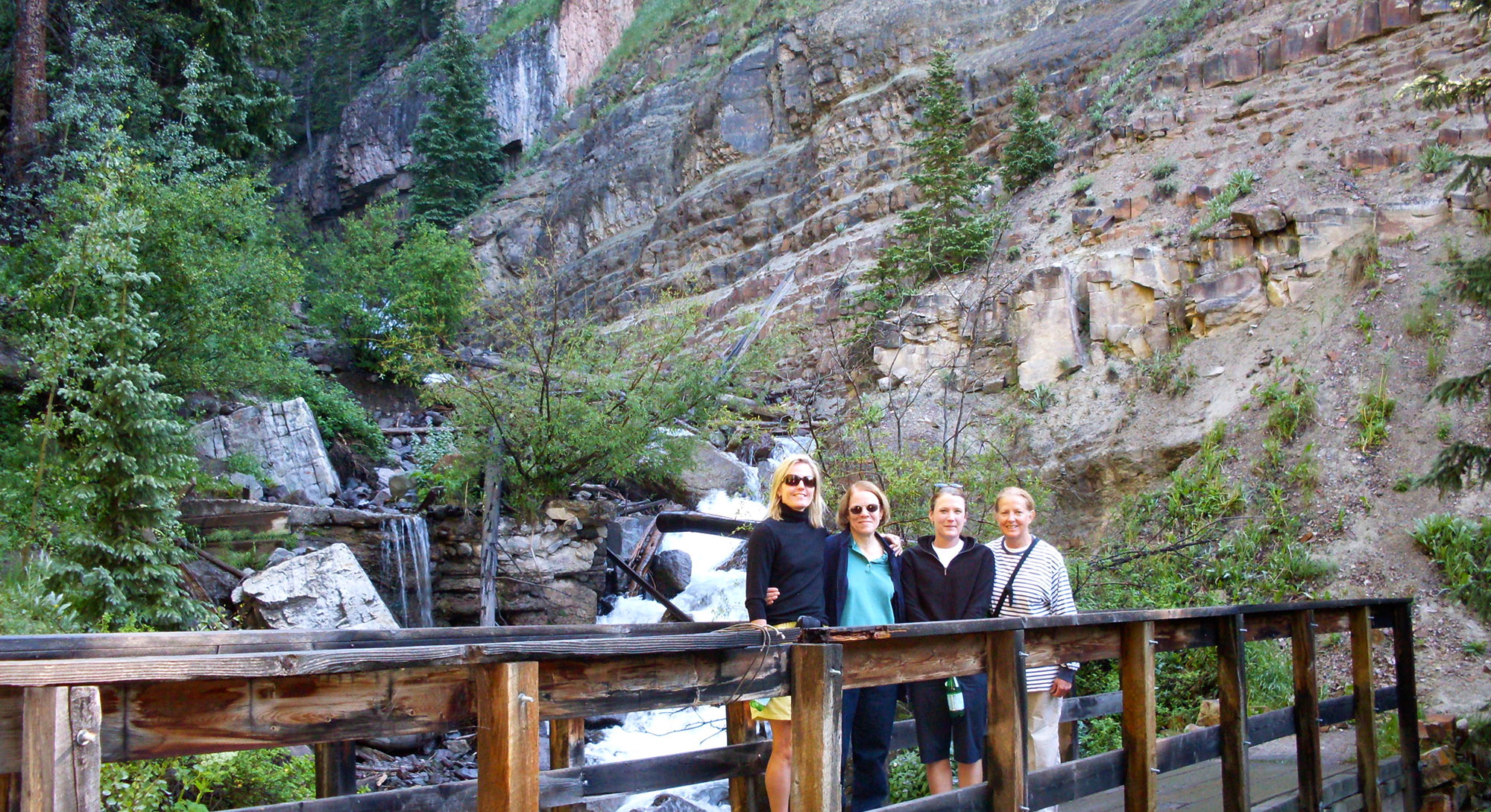Group of Women standing on a bridge in Telluride